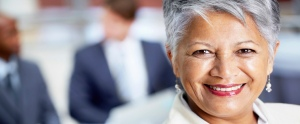 Closeup portrait of a professional ethnic businesswoman smiling during a business meeting - copyspace