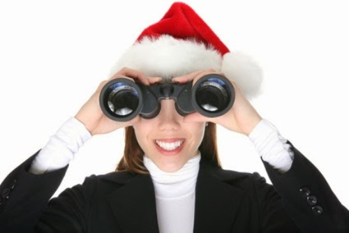 A pretty business woman with binoculars at Christmas